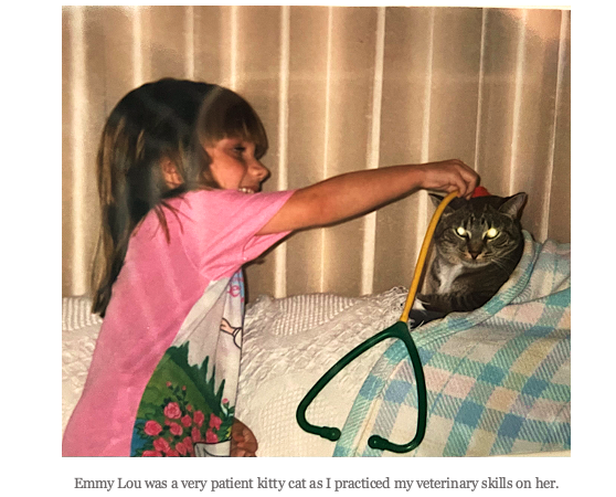 A picture of the author as a child with her cat: Emmy Lou was a very patient kitty cat as I practiced my veterinary skills on her.