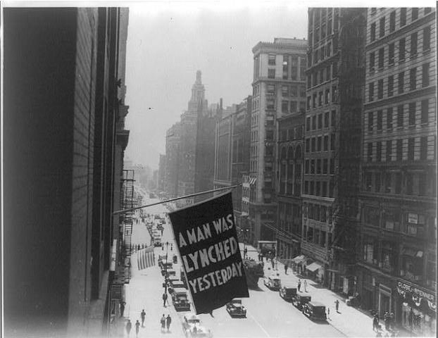 A flag on a NYC building that reads: A man was lynched yesterday.