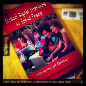 """photo of book """"Critical Digital Literacies as Social Praxis"""" sitting on envelope used to ship it"""