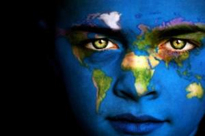 woman's face with full-color topographical globe painted on skin